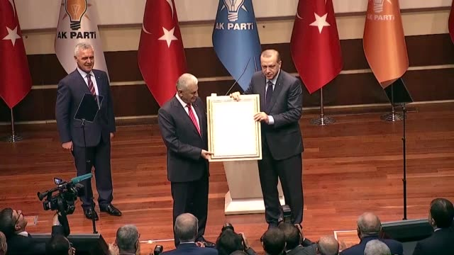 turkish president recep tayyip erdogan receives the founder membership declaration from turkish prime minister binali yildirim after rejoining the... - founder stock videos and b-roll footage