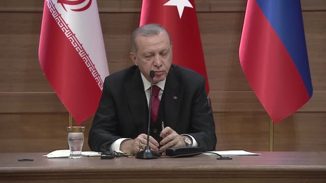 Turkish President Recep Tayyip Erdogan speaks at a joint press conference with Iranian President Hassan Rouhani and Russian President Vladimir Putin...