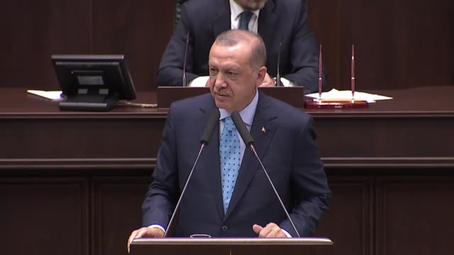 Turkish President Recep Tayyip Erdogan speaks at his ruling Justice and Development Party's parliamentary group meeting on July 24 208 in Ankara...