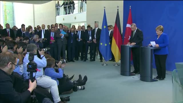 turkish president recep tayyip erdogan speaks at joint press conference with german chancellor angela merkel following their meeting in berlin... - 後を追う点の映像素材/bロール