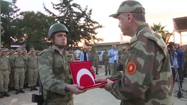 turkish president recep tayyip erdogan wearing military uniform inspects troops taking part in the afrin operation on april 01 2017 in the southern... - military uniform stock videos and b-roll footage