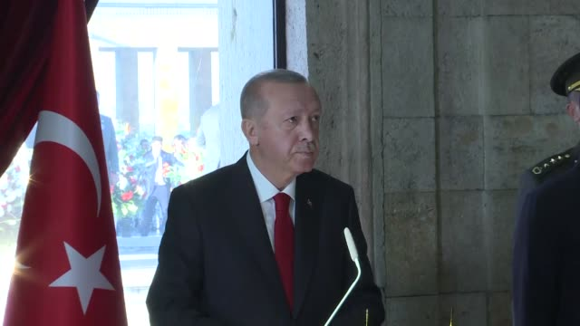turkish president recep tayyip erdogan writes a message on the book of commemoration to pay tribute to mustafa kemal ataturk, the founder of republic... - ムスタファ ケマル アタテュルク点の映像素材/bロール