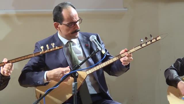 Turkish Presidential Spokesman Ibrahim Kalin plays the baglama and sings traditional Anatolian music at the Ankara Fine Arts High School on November...