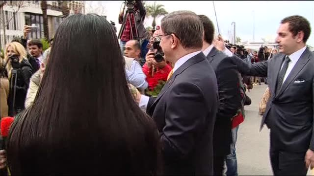 turkish prime minister ahmet davutoglu and greek prime minister alexis tsipras present red roses to female journalists on the occasion of... - internationaler frauentag stock-videos und b-roll-filmmaterial