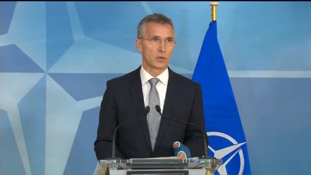 Turkish Prime Minister Ahmet Davutoglu and NATO Secretary General Jens Stoltenberg hold a joint press conference following their meeting at the NATO...