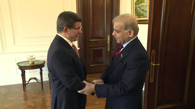 turkish prime minister ahmet davutoglu and pakistan's punjab chief minister muhammad shahbaz sharif are seen during their meeting at cankaya palace... - punjab pakistan stock videos and b-roll footage
