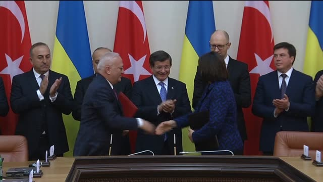 Turkish Prime Minister Ahmet Davutoglu and Ukrainian Prime Minister Arseniy Yatsenyuk attend a signing ceremony of bilateral agreements following...