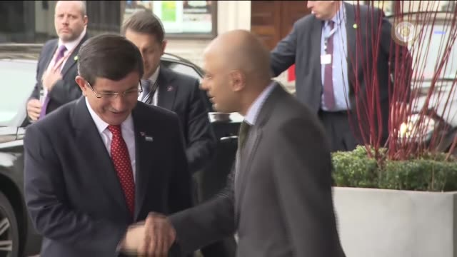 Turkish Prime Minister Ahmet Davutoglu arrives at the Queen Elizabeth II Conference Centre to attend the The Supporting Syria and the Region...