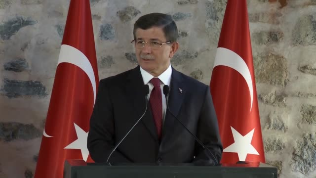 Turkish Prime Minister Ahmet Davutoglu delivers a speech alongside US Vice President Joe Biden during a press conference following their meeting in...