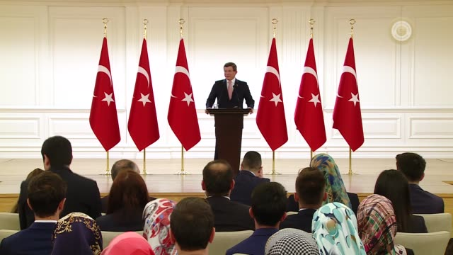 Turkish Prime Minister Ahmet Davutoglu delivers a speech as he receives young people from 81 provinces across Turkey during a reception marking the...
