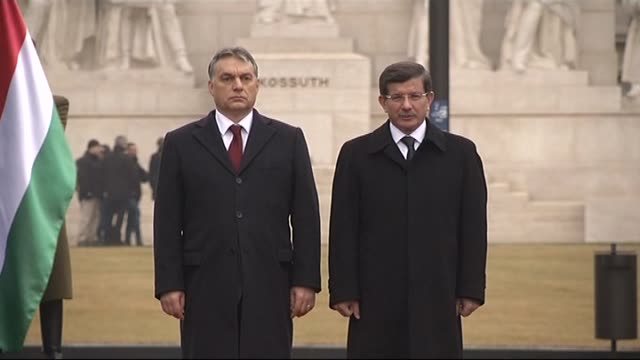 turkish prime minister ahmet davutoglu is welcomed by hungary's prime minister viktor orban with an official ceremony at the parliament building in... - 2015 stock-videos und b-roll-filmmaterial