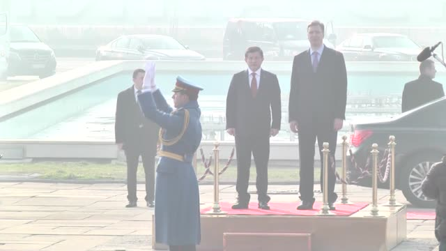 turkish prime minister ahmet davutoglu is welcomed by serbian prime minister aleksandar vucic in belgrade, serbia on december 28, 2015. turkish pm... - トルコ首相点の映像素材/bロール