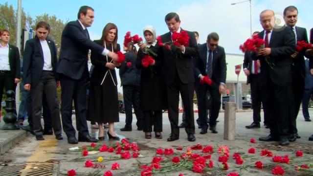 turkish prime minister ahmet davutoglu leave carnations at scene of bomb blast outside main train station nearby sihhiye square in ankara, turkey on... - prime minister bildbanksvideor och videomaterial från bakom kulisserna