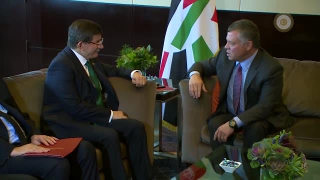 Turkish Prime Minister Ahmet Davutoglu meets with Jordanian King Abdullah II during his visit to New York United States on September 27 2015