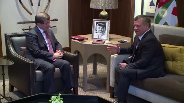 Turkish Prime Minister Ahmet Davutoglu meets with King Abdullah II of Jordan in Amman Jordan on March 27 2016