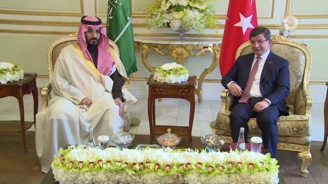 turkish prime minister ahmet davutoglu meets with saudi defense minister prince mohammed bin salman in riyadh, saudi arabia on january 31, 2016. - türkischer premierminister stock-videos und b-roll-filmmaterial