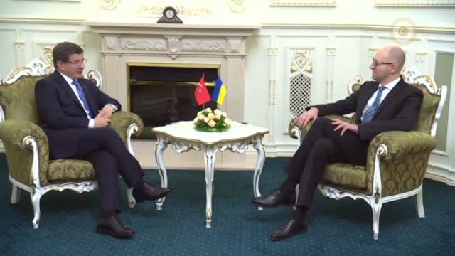 Turkish Prime Minister Ahmet Davutoglu meets with Ukrainian Prime Minister Arseniy Yatsenyuk in Kiev Ukraine on February 15 2016