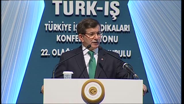 turkish prime minister ahmet davutoglu speaks during a conference in ankara, turkey on 5 december, 2015. - トルコ首相点の映像素材/bロール