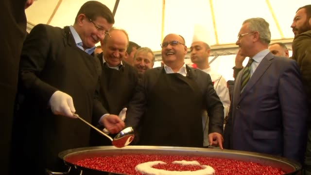 turkish prime minister and justice and development party leader, ahmet davutoglu dsitribute ashure, a turkish dessert served during the first month... - ashura muharram stock videos & royalty-free footage