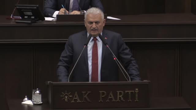 turkish prime minister and the leader of turkey's ruling justice and development party binali yildirim speaks during the ak party's group meeting at... - türkischer premierminister stock-videos und b-roll-filmmaterial