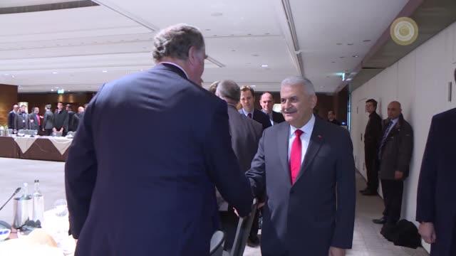 Turkish Prime Minister Binali Yildirim accompanied by Turkey's EU Minister and Chief Negotiator Omer Celik and Turkey's Economy Minister Nihat...