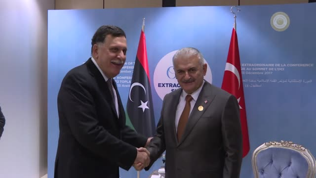 turkish prime minister binali yildirim and fayez alsarraj head of libya's unbacked unity government hold a meeting on the sidelines of the... - türkischer premierminister stock-videos und b-roll-filmmaterial