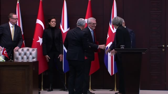Turkish Prime Minister Binali Yildirim and his British counterpart attend a joint press conference after their meeting in Ankara Turkey on January...