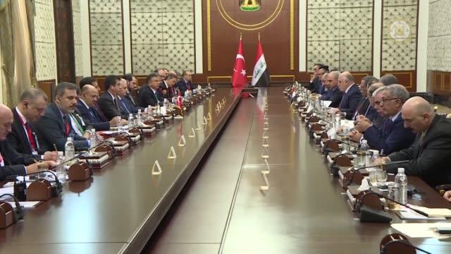 turkish prime minister binali yildirim and his iraqi counterpart haidar al-abadi attend the meeting of turkey- iraq high level strategic cooperation... - トルコ首相点の映像素材/bロール