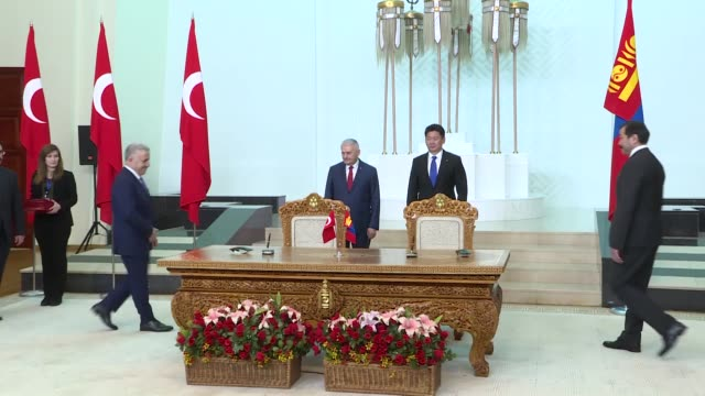 Turkish Prime Minister Binali Yildirim and his Mongolian counterpart Khurelsukh Ukhnaa attend a signing ceremony for cooperative agreements between...