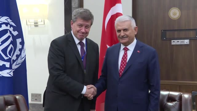 Turkish Prime Minister Binali Yildirim and ILO DirectorGeneral Guy Ryder hold a meeting on the sidelines of the 10th European Regional Meeting of the...