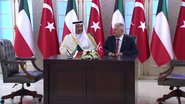 turkish prime minister binali yildirim and kuwaiti prime minister sheikh jaber almubarak alhamad alsabah attend signing ceremony of agreements... - türkischer premierminister stock-videos und b-roll-filmmaterial