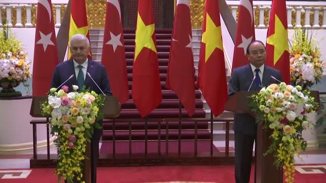 turkish prime minister binali yildirim and vietnamese prime minister nguyen xuan phuc attend a joint press conference following tehir meeting at the... - binali yildirim stock-videos und b-roll-filmmaterial