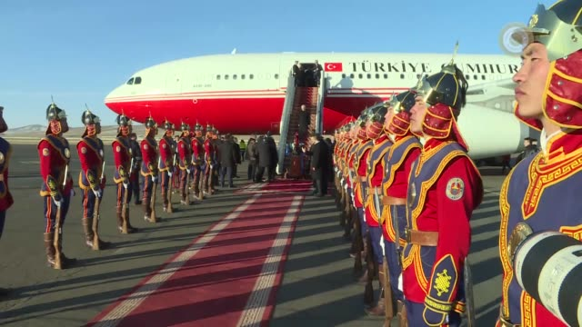turkish prime minister binali yildirim arrives in the mongolian capital ulaanbaatar on april 06 2018 for a twoday visit he was accompanied by deputy... - türkischer premierminister stock-videos und b-roll-filmmaterial
