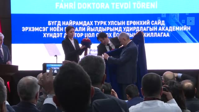 Turkish Prime Minister Binali Yildirim attends a ceremony at National University of Mongolia for receiving an honorary PhD in Ulaanbaatar Mongolia on...