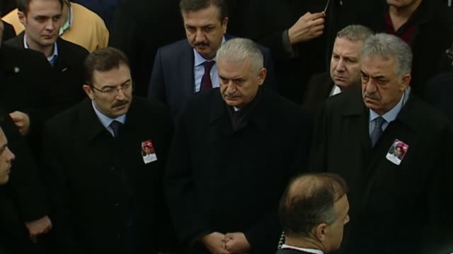 Turkish Prime Minister Binali Yildirim attends a funeral ceremony for chief police officer Kadir Yildirim who was martyred in the twin deadly terror...