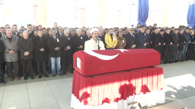 turkish prime minister binali yildirim attends a funeral ceremony for turkish soldier yunus emre duran who was martyred in a terror attack in... - トルコ首相点の映像素材/bロール