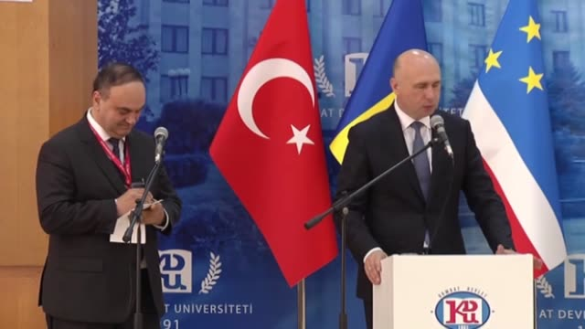 turkish prime minister binali yildirim attends the ceremony of receiving the title of honorary phd from comrat state university during his visit in... - türkischer premierminister stock-videos und b-roll-filmmaterial
