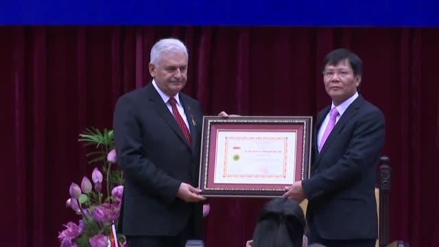 turkish prime minister binali yildirim attends the distinguished medal of honour in social sciences award ceremony at vietnam academy of social... - binali yildirim stock-videos und b-roll-filmmaterial