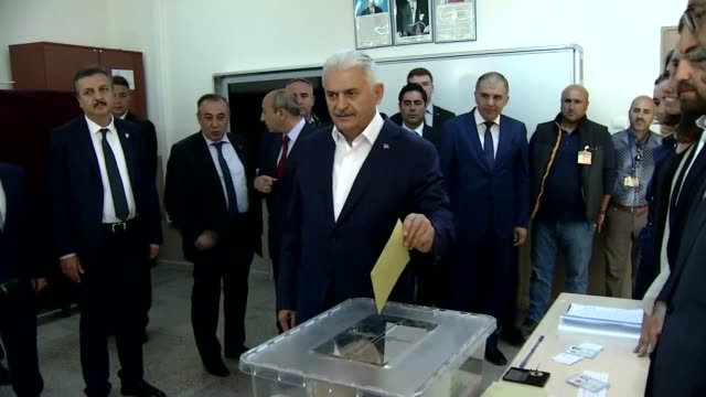 turkish prime minister binali yildirim casts his ballot for the constitutional referendum at a polling station in izmir turkey on april 16 2017 more... - türkischer premierminister stock-videos und b-roll-filmmaterial