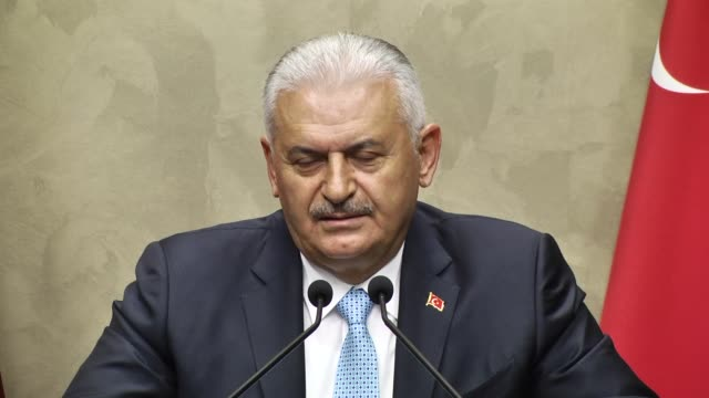 turkish prime minister binali yildirim delivers a speech during a press conference ahead of his departure two-day visit to moldova, at the esenboga... - トルコ首相点の映像素材/bロール