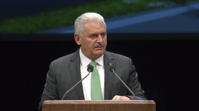 turkish prime minister binali yildirim delivers a speech during city planning council meeting at bestepe people's congress and culture center in... - トルコ首相点の映像素材/bロール