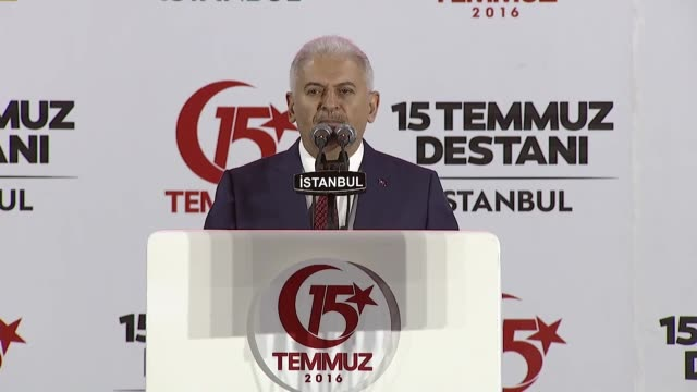 Turkish Prime Minister Binali Yildirim delivers a speech during the July 15 Democracy and National Unity Day's events to mark July 15 defeated coup's...