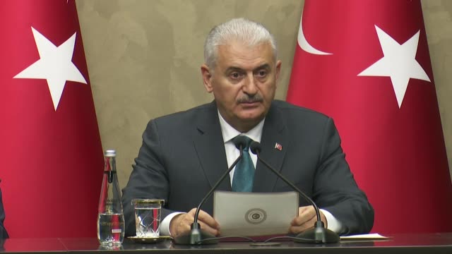 turkish prime minister binali yildirim holds a press conference at esenboga international airport before his departure to south korea for an official... - binali yildirim stock-videos und b-roll-filmmaterial
