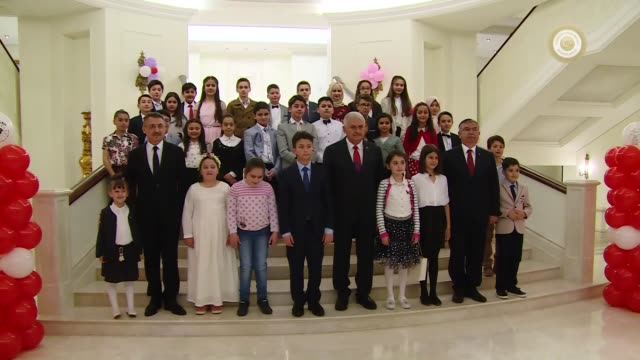 turkish prime minister binali yildirim holds a symbolic cabinet meeting with a group of children at the cankaya palace on national sovereignty and... - türkischer premierminister stock-videos und b-roll-filmmaterial