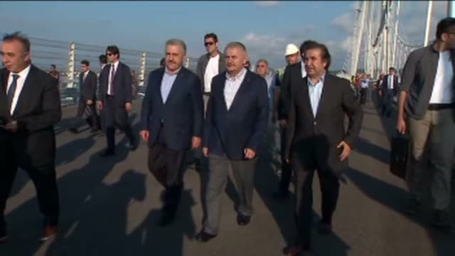 turkish prime minister binali yildirim inspects the yavuz sultan selim bridge, the bridge which unites the asian and european sides of the bosporus... - yavuz sultan selim bridge stock videos & royalty-free footage