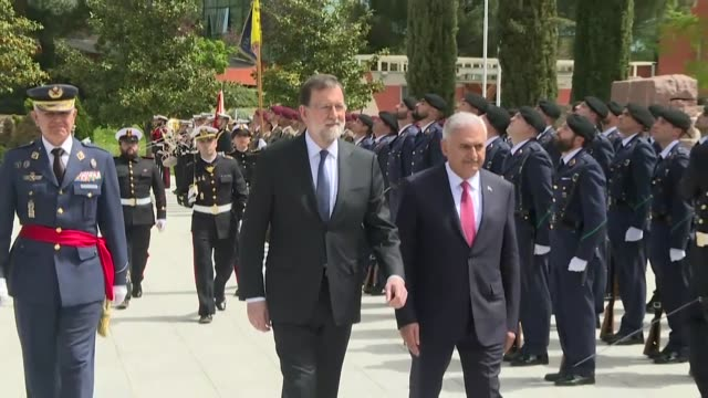 turkish prime minister binali yildirim is welcomed by spanish prime minister mariano rajoy with an official ceremony in madrid spain on april 24 2018 - türkischer premierminister stock-videos und b-roll-filmmaterial