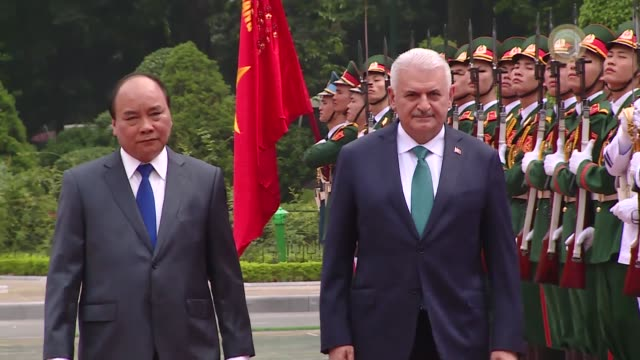 Turkish Prime Minister Binali Yildirim is welcomed by Vietnamese Prime Minister Nguyen Xuan Phuc with an official welcoming ceremony at the...