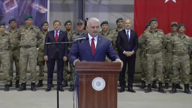 turkish prime minister binali yildirim makes a speech during his visits to the turkish military training centre at the hamid karzai international... - primo ministro turco video stock e b–roll