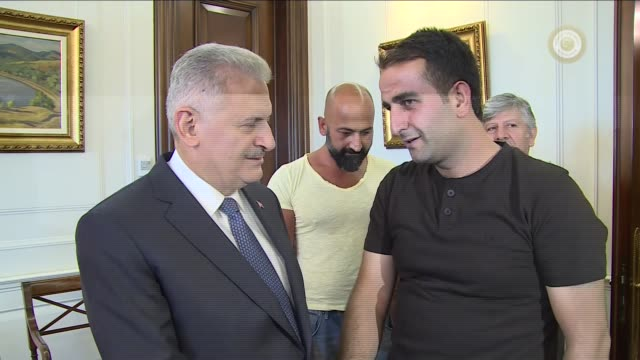 turkish prime minister binali yildirim meets with a group of citizens defiant against parallel state/gulenist terrorist organization's 15th of july... - armored truck stock videos and b-roll footage