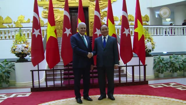 Turkish Prime Minister Binali Yildirim meets with his Vietnamese counterpart Nguyen Xuan Phuc at the presidential palace in Hanoi Vietnam on August...